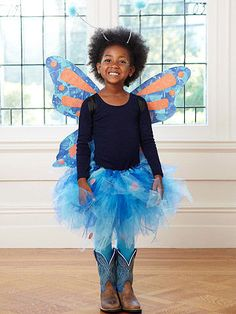 """A sweet, delicate creature sparkles with wings that she made from tissue paper and glitter.                 Tutu What you'll need Elastic, hot-glue gun,  6 yards of tulle, glitter paper, scissors  Make it  1 Knot or glue elastic to fit around child's waist. 2 Cut tulle into 29""""x4"""" strips. Fold top 3"""" of tulle over and make a 1?"""" slit into the fold. 3 Around the elastic, insert long end through slit and carefully pull. Repeat until elastic is covered with tulle strips. Scrunch with hands to…"""