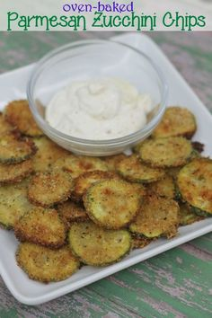 Oven baked parmesan zucchini chips recipe- so crunchy, so delicious- and so much less guilt! part of the kids in the kitchen series from This Mama Loves.