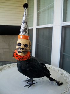 Skull Head Crow - the skull and the crow are sold at Dollar Tree - just glue them together  :)