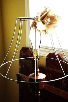 DIY shabby chic lamp...they say shabby chic/farmhouse chic , could be anthroplogish too ...paint the lamp or change the flower.... I like this idea