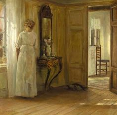 Carl Vilhelm Holsoe (Danish artist, 1863-1935) Interior with Lady and Cat