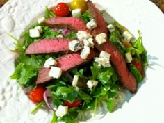 Arugala steak salad with honey lime vinaigrette @ http://chefbryanwoolley.com/2010/07/14/arugula-steak-salad-w-honey-lime-vinaigrette/