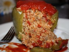 Stuffed Pepper __This recipe includes a red sauce that sounds good and might make a good topping for meatloaf. Something to think about.