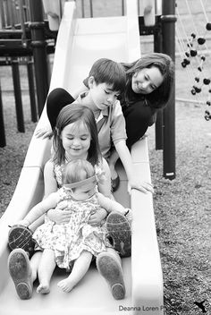 8-month-old + siblings outdoor picture ideas | Black and white on a playground slide | Deanna Loren Photography