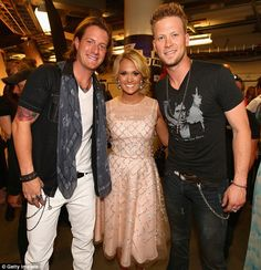 Big winners: Carrie Underwood with musicians Tyler Hubbard (L) and Brian Kelley (R) of Florida Georgia Line