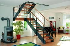 Wooden staircase Loft half-turned narrow staircase with stainless steel railing wooden handrail and pedestal Source by TreppenmeisterGmbH Narrow Staircase, Loft Staircase, Wooden Staircases, Modern Staircase, Staircase Design, Stairs, Escalier Design, Stainless Steel Railing, Metal Homes