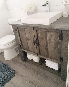 Love the DIY rustic bathroom vanity cabinet (Diy Bathroom Remodel) Rustic Bathroom Designs, Rustic Bathroom Vanities, Rustic Bathroom Decor, Bathroom Vanity Cabinets, Bathroom Storage, Vanity Sink, Country Bathrooms, Rustic Decor, Glass Bathroom