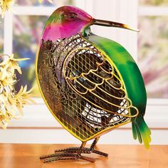 Deco Breeze Hummingbird Table Fan // Let this charming Hummingbird Shaped Decorative Figurine Fan brighten your day while it keeps you cool. With its decorative appeal, a Figurine Fan can easily become a permanent part of any desk, vanity, bedroom, kitchen, or bathroom decor.