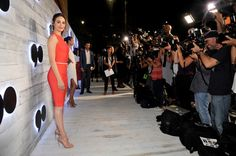 Emmy Rossum struck a pose in front of a throng of photographers at the VIP sneak peek of the go90 Social Entertainment Platform in Los Angeles.