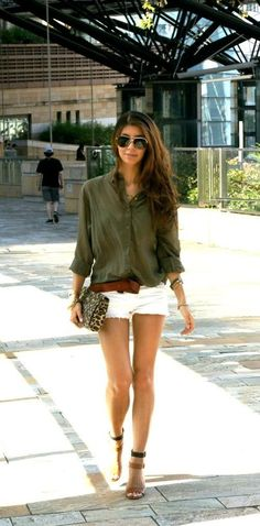 Master the effortlessly chic look in an olive green button front blouse and white denim shorts. A pair of tan leather heeled sandals will seamlessly integrate within a variety of outfits.   Shop this look on Lookastic: https://lookastic.com/women/looks/button-down-blouse-shorts-heeled-sandals/18900   — Black Sunglasses  — Olive Button Down Blouse  — Olive Bracelet  — Brown Leather Belt  — Tan Leopard Suede Clutch  — White Denim Shorts  — Tan Leather Heeled Sandals
