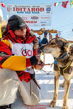 "Mitch Seavey poses with his star lead dog ""Pilot"" at the finish line after winning his third Iditarod in record time of 8 days, 3 hours, 40 minutes and 13 seconds in Nome during the 2017 Iditarod on Tuesday afternoon March 14, 2017.Photo by Jeff Schultz/SchultzPhoto.com (C) 2017 ALL RIGHTS RESERVED"