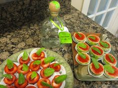 MICHELE'S STRAWBERRY MARGARITA JELLO SHOT    1 box Strawberry Jello  1/2 Cup Tequila  1/2 Cup cold Water  1 Cup Margarita Mix (I used (light w/ no sugar)   Sugar   Mint for garnish  Limes  Strawberries         When chilled- dip strawberries in tiny bit of lime juice- then sugar- place in small cupcake liner - garnish with mint leaf - limes don't need to be dipped- just roll rim in sugar - garnish w/ mint leaf. Place back in to fridge to chill some more.