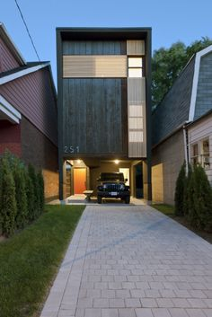 Shaft House by Reza Aliabadi. A thing of thoughtful beauty surrounded by mediocrity; and it didn't cost much more than the adjacent homes.