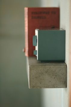 concrete shelves...could totally make these and use large bolts at the bottom instead of the floating look.