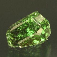 Tsavorite, emerald green form of Grossular. Found in contact metasomatic deposits. Calcium/ Silicon/ Aluminum