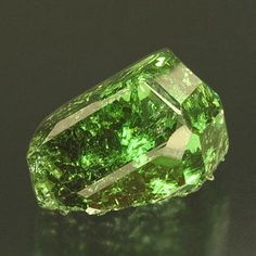 Tsavorite, emerald green form of Grossular. Found in contact metasomatic deposits. Calcium/ Silicon/ Aluminum