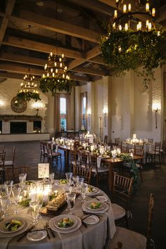 Beautiful candlelit wedding reception table with greenery decorated chandeliers - Courtney Inghram Early Mountain Vineyard Charlottesville Virginia Wedding Florist #weddingreception #receptiondecor #virginiaweddingflorist
