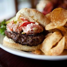 A juicy burger topped with lobster salad at The Wharf Pub on Martha's Vineyard