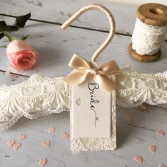My philosophy is that every wedding dress deserves a beautiful hanger, I design elegant wedding hangers so that stunning dresses can hang on gorgeous hangers. A beautiful hand sewn wedding dress hanger, crafted from ivory embroidered tulle lace and finished with a luxury handmade label which can b