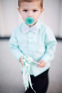 The ring bearer and flower girl waved fabric wands as they walked down the aisle