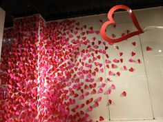 With a little patience, a good movie and a glass of wine - I can get ready to do this Valentine window display