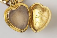 Given to Queen Victoria by Prince Albert, gold chain bracelet to which enamelled heart shaped lockets of different colours were added as each child of her nine was born; containing the hair of Queen Victoria's children. Royal Collection Trust.
