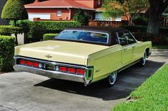 1972 Lincoln Continental, yellow. These cars would never again be this large, or this plush.