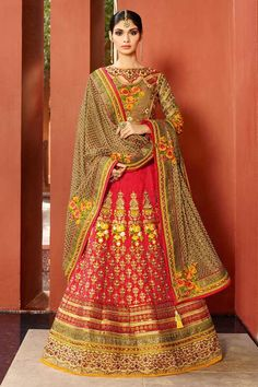 Dark beige, art silk semi stictch lehenga choli.  Embellished with embroidered, resham, zari and stone.   It is perfect for festival wear, party wear and wedding wear.  0.80 mtr Choli : 2.25 mtr Dupatta : 3 mtr Lehenga. and unstitched blouse. http://www.andaazfashion.com/womens/lehenga-choli/partywear