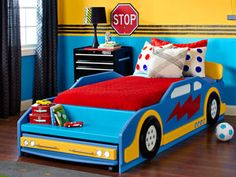 Tutorial: how to make this race car bed, as well as other themed decor (tire track border, racetrack playmat, pillows and speedway flag coat hooks).