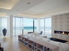 Great Sea Views of Minimalist White Living Room Design with Flat Wooden Bookcase Furniture Ideas also Line Modern Fireplace Design in the Stone Wall Design for Beautiful Views of Contemporary Living Room Designs Beach Living Room, Coastal Living Rooms, Living Room Modern, Interior Design Living Room, Living Room Designs, Living Room Decor, Cozy Living, Living Area, Apartment View
