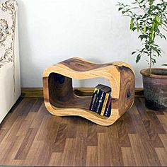 The wave bench features a scooped trough to provide a comfortable, roomy seat that gently slopes up on either side. Set on end, the stool adds its sculptural accent as a side table with useful storage area. Furniture, Natural Wood Decor, Wood Decor, Wooden, Beautiful Wood, Wood Blocks, Wooden Bench, Monkey Pod Wood, Coffee Table