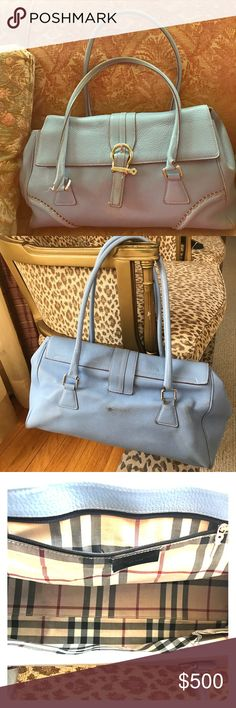 Burberry soft pebbled satchel Gorgeous light blue used  with love authentic  vintage Burberry soft pebble leather bag. Double handles to either hold on your arm or on your shoulder.  Magnetic lock embellished with silver metal buckle. Beautiful Burberry signature fabric lined interior with a zipper compartment and cell phone pocket.  Some wear on handles and bottom corners. Some discoloration on the back from rubbing on my clothes. Interior is in great condition no stains Burberry Bags…