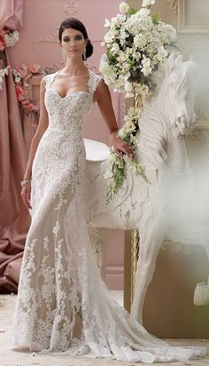 Sophisticated Queen Anne neckline fit-and-flare wedding dress; Featured Dress: David Tutera