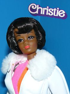 Mattel introduced Christie in 1968. Their first attempt in 1967 in launching an African American doll flopped. She had the same face as Christie, but the (smaller) body of Barbie's cousin Francie. Mattel received tons of complaints that she didn't fit into Barbie's clothes, so Christie was launched a year later & could wear Barbie fashions.