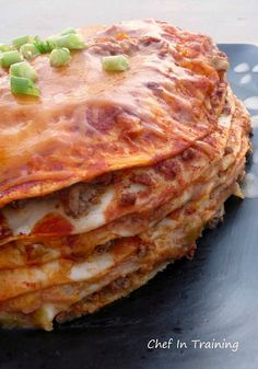 Cheesy Enchilada stack!    CHEESY ENCHILADA STACK1 lb. Lean ground beef2 (10 oz) can Red Enchilada Sauce (Our favorite is the Old El Paso brand)6 (8 inch) flour tortillas1 (8 oz) bag Shredded Cheddar Cheese1 (16 oz) can refried beans (or you can make your own, check out my mom's recipe for her famous homemade refried beans!)2 (4 oz) cans diced gr