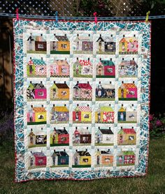 House quilt with family pictures in the windows and doors!