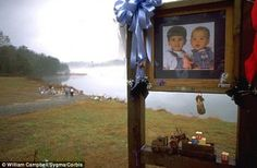 Sad: A memorial to the young sons Smith murdered in 1994 sits beside the lake in which the boys were purposely drowned
