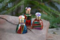 The perfume bottle made from Italian glass are available at My Italian Decor. Each bottle has a unique shape and design.  #authenticitalianglass #muranoglass #muranoitalianglass #italianglass