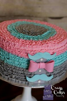 Mustaches and bows gender reveal cake
