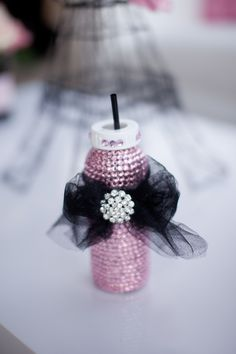 so cute for the mother to be as her drink cup at her shower. picture only but would be easy with a plastic baby bottle, mod podge, crystals & ribbon.