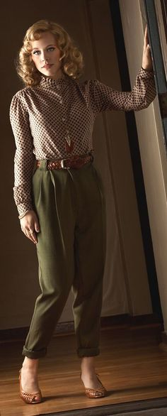 land girl style with a slightly modern twist. Classic fit khaki trousers, with a smart patterned shirt. Lovely day look which could be dressed up with a smart jacket or coat. hair completes the outfit.