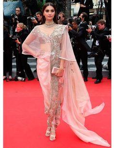 The Cannes Film Festival 2014 | ELLE UK..... Sonam Kapoor wearing Anamika Khanna to theFoxcatcherpremiere at the Annual Cannes Film Festival.