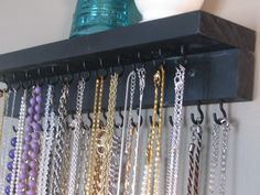 Necklace organizer. I just made one like this (except purple, of course!) Very practical!!