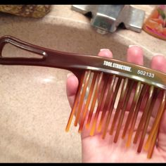 Best comb ever for combing out curly hair. Found it at Sally's Beauty Supply.