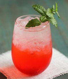 Passion Fruit Rum Cocktail (1 part Cruzan Passion Fruit Rum 3 parts club soda Splash of grenadine)