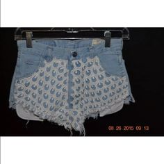 Urban Outfitters High wasted Shorts Urban outfitters high wasted denim shorts. Has design on the front and barely worn. Size XS. Urban Outfitters Shorts Jean Shorts