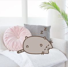 Pusheen napping on the couch