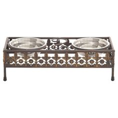Perfect for holding kibble and treats, this iron pet feeder showcasing 2 removable bowls and an openwork floral design.   Product: