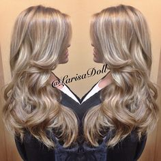 Medium ashy beige blonde base with full head of silver blonde balayaged highlites