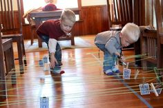 A string obstacle course setup for kids to practice number bonds to 10 or matching numbers. A fun way to get kids moving and learning about numbers!